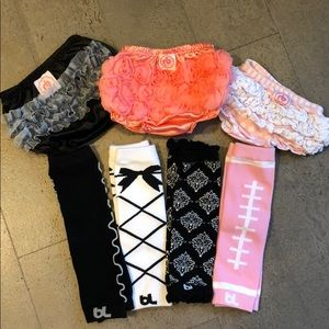 Bundle of baby girl diaper covers and leg warmers